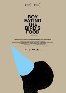 BOY EATING THE BIRD'SFOOD